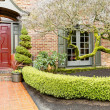 Stock Photo: Classic brick house entrance with trim hedge