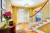 Bright yellow and white entrance hall — Stock Photo
