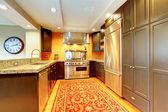 Shiny kitchen with black wood cabinets — Stock Photo