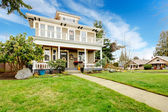 Two story american house with white column porch — Stock Photo