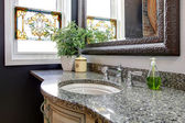 Great combination of marble, rustic framed mirror and mosaic win — Stock Photo