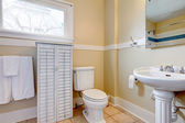 Bright bathroom with white wood cabinet — Stok fotoğraf
