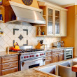 Wood kitchen room with decorated tile backsplash — Stock Photo