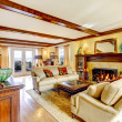 Impressive living room with ceiling beams and fireplace — Stock Photo
