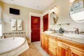 Modern bathroom with whirpool and tv — Stockfoto