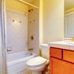 Cozy light yellow bathroom — Stock Photo #39935915