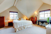 Vaulted ceiling elegant bedroom — Stock Photo