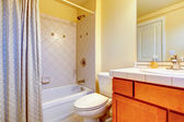 Cozy light yellow bathroom — Stock Photo