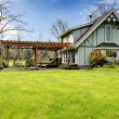 Stock Photo: Beautiful farmhouse with attached pergola. Early spring