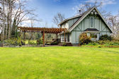 Beautiful farmhouse with attached pergola. Early spring — Stock Photo