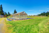 Farm with greenhouse — Стоковое фото
