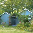 Flourishing farm backyard with sheds and garden house — Stock Photo #40034327
