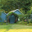 Flourishing farm backyard with sheds and garden house — Stock Photo #40034535