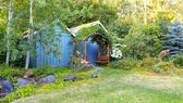 Farm backyard with sheds and garden house — Stock Photo