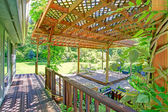 Backyard farm deck with attached open pergola — Stock Photo
