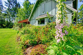 Big farmhouse with beautiful flowerbed — Foto de Stock