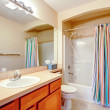 Bright bathroom wtih colorful curtains — Stock Photo