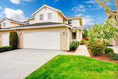 Backyard with garage and picturesque curb appeal — Stock Photo