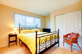 Light tones bedroom with antique iron fram bed — Photo