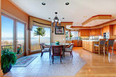 Luxuriant round kitchen room and dining area with walkout deck — Stock Photo
