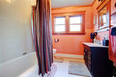 Cozy white and orange bathroom — Stock Photo