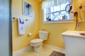 Yellow bright bathroom — Stock Photo