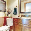 Bathroom with antique washbasin cabinet — Stock Photo #40918513