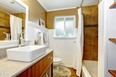 Brown and white cozy bathroom wtih window — Stock Photo