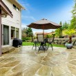 Постер, плакат: Home patio area overlooking beautiful landscaping