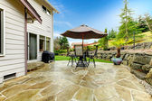 Home patio area overlooking beautiful landscaping — Stock Photo