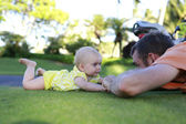 Cute baby is playing with father — Stock Photo