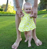 Excited baby girl. First steps — Stock Photo