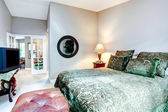 Elegant bedroom with queen size bed — Stock Photo