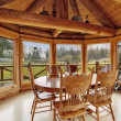 Beautiful dining room in log cabin house — Stock Photo #41706333