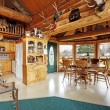 Beautiful dining room in log cabin house — Stock Photo #41706563