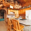 Kitchen room in log cabin house — Stock Photo