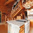 Log cabin house interior. View of entrance hall form kitchen roo — Stock Photo