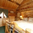 Cozy bedroom in log cabin house — Stock Photo #41706631