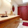 Cozy bathroom with red rug and curtains — Stock Photo