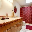 Stock Photo: Cozy bathroom with red rug and curtains