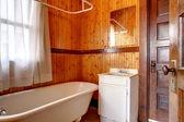 Plank wall small bathroom — Stock Photo