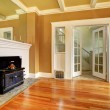 Empty old living room with an antique stove — Stock Photo #41896865