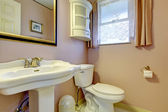 Peach old fashion bathroom with a window — Stock Photo