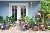Exterior wall with french door decorated with flowers — Stock Photo
