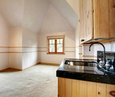 Spacious empty kitchen with cathedral ceiling — Photo