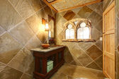 Amazing castle style bathroom with an arch window — Stock Photo