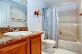 View of the washbasin cabinet and bath tub. — Stock Photo