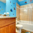 Stock Photo: Bathroom with an aqua designed wall