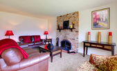 Living room with a brick fireplace — Stock Photo