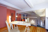 Reconstructed mezzanine office overlooking living room — Stock Photo